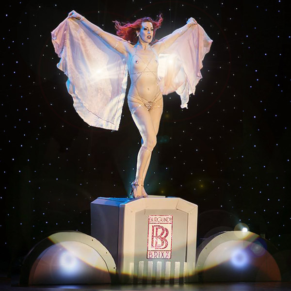 """Me as Burgundy Brixx competing in my Rolls Royce number for the world title of """"Reigning Queen of Burlesque"""" in Las Vegas, 2013."""